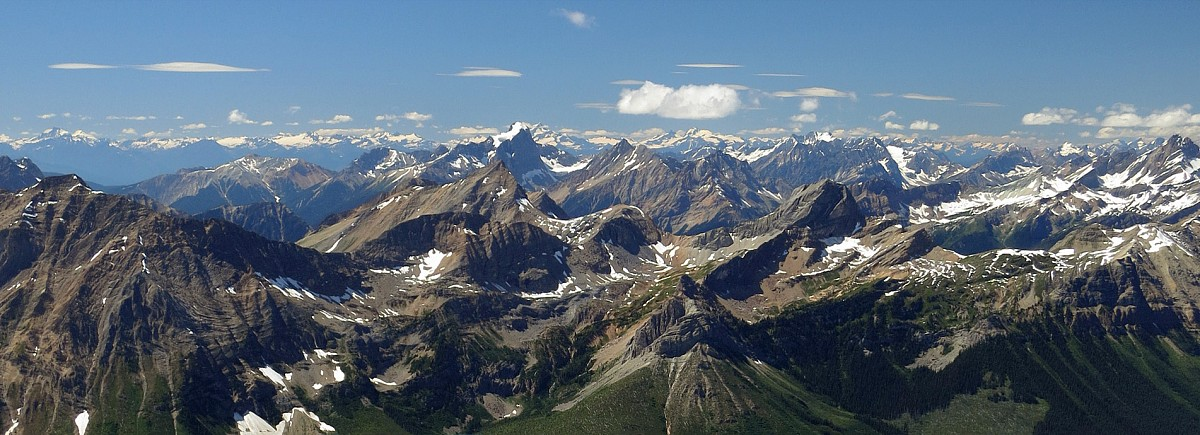 The spectacular western panorama towards Roger's Pass from the summit of Kiwetinok Peak