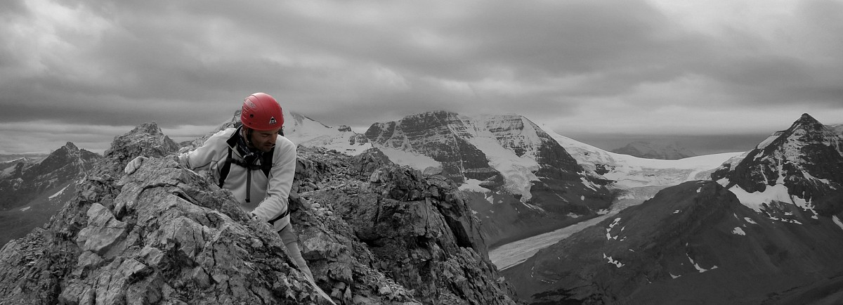 Greg carefully makes his way along the exposed ridge towards the summit.