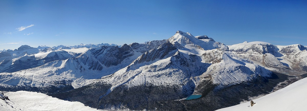 A lovely Icefields panorama unfolds with Boundary Lake in the foreground.