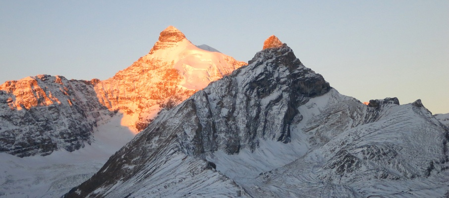 Dawn breaks upon the eastern faces of Mt. Athabasca and Hilda Peak