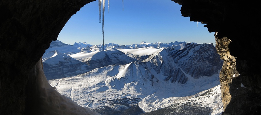 A high cave near the ridge crest offers a sheltered place to consider the Lyells and distant Mt. Alexandra.