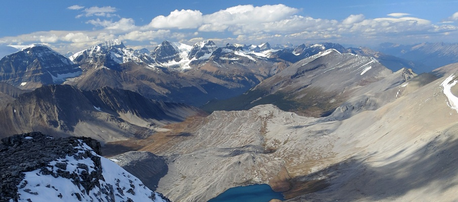 Climbing up Nigel's summit ridge affords lovely views of Wilcox Lake and the giants of the Churchill Range beyond.