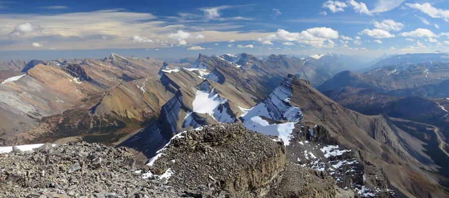 A sea of windswept peaks adorn the beautiful southern summit panorama