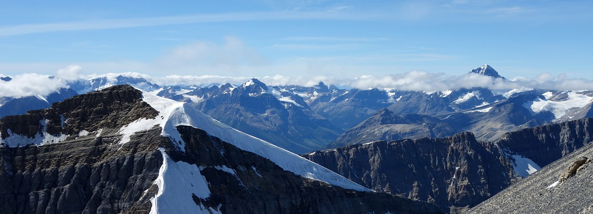 A spectacular view from Chephren's summit beyond White Pyramid towards the giant, Mt. Forbes