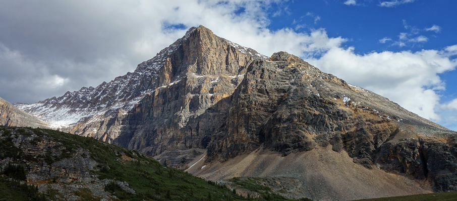 The impressive north face of Verdant Peak from Verdant Pass. The ascent route follows the ramp to the right.