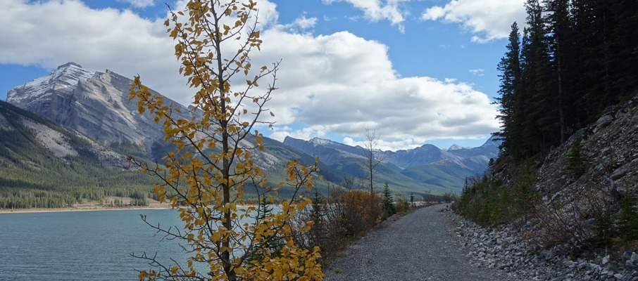 Riding along the trail on the approach with Mt. Sparrowhawk visible across the Spray Lakes.