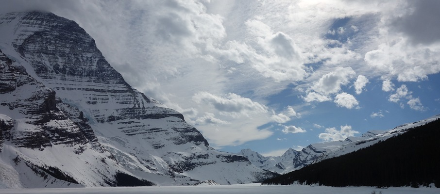 Stormy skies begin to break up in this view of Mt. Robson from the far end of Berg Lake.