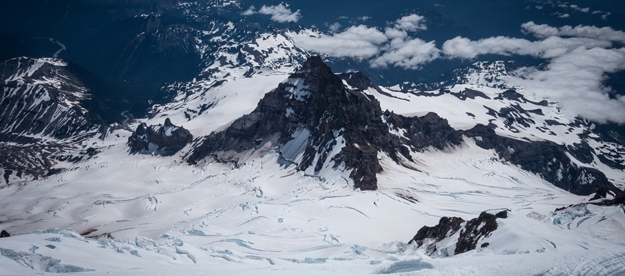 The iconic view of Rainier's sibling Little Tahoma is visible for most of the DC route ascent/descent.