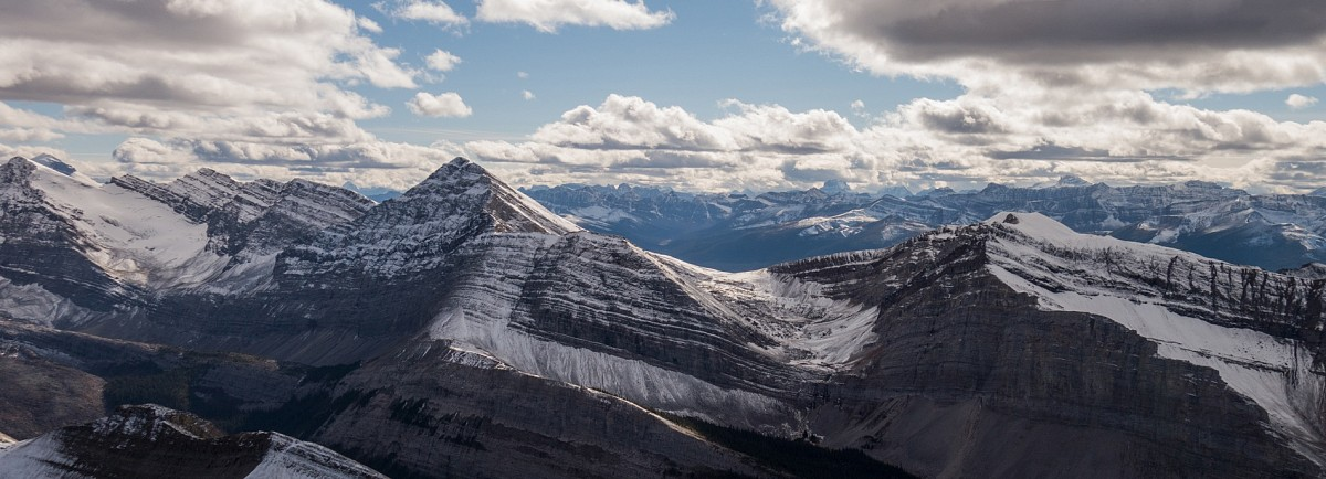 Gazing past Opal Peak (centre left) towards the Maligne Lake region from Alpland's summit.