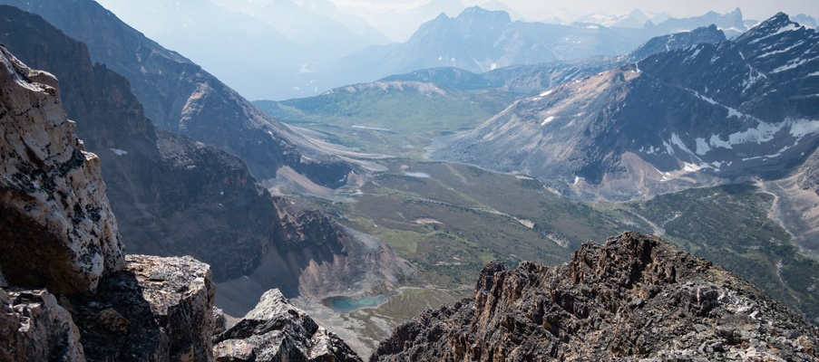The view of Verdant Pass midway up the ascent route towards a smoky Hooker Icefields region.