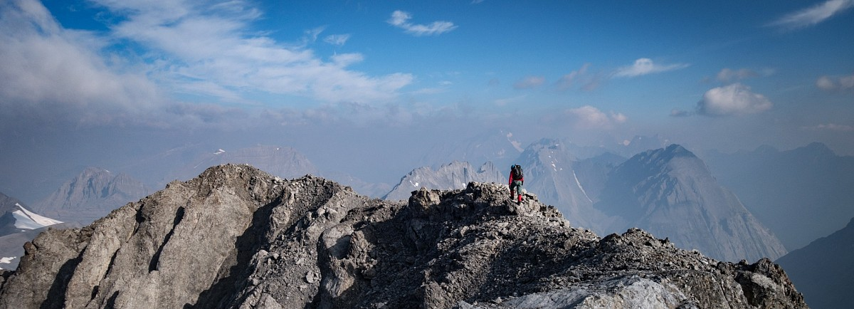 Heavy forest fire smoke obstructs the northern views as Doug traverses the summit ridge.