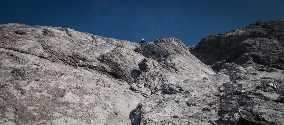 Gazing up the 5th-class crux pitch of Mount Northover as Alex tops-out on the exit chimney.