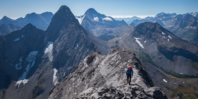 The spectacular Mt. Birdwood dominates the view next to Sir Douglas and Snow Peak as Tamas traverses the summit ridge.
