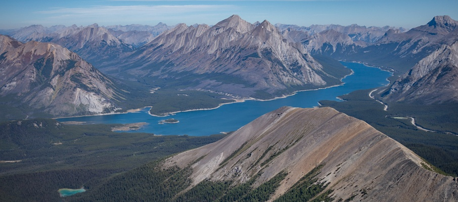 The summit offers a great view of the Spray Lakes past Tent Ridge with Mt. Nestor in the distance.