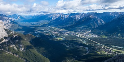 The verdant Town of Canmore from the summit of Middle Sister