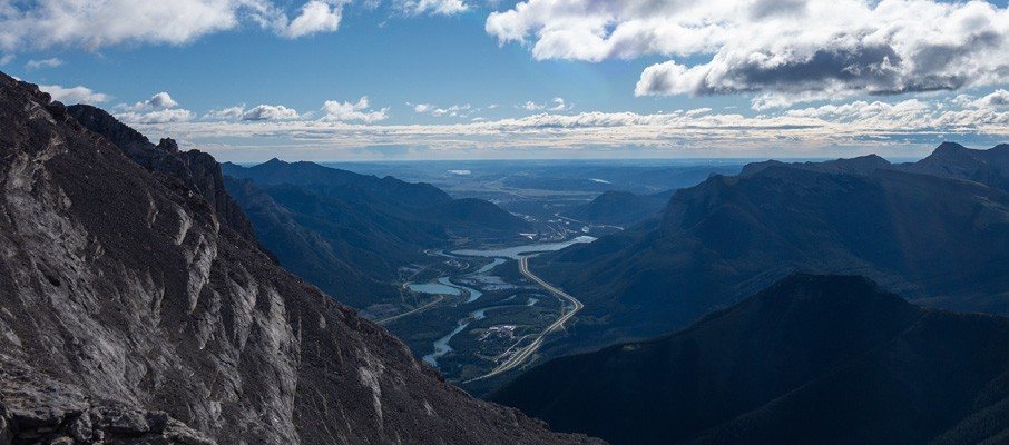 Gazing along the TransCanada highway and Bow River, past Lac des Arcs, to the prairies beyond.