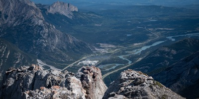 A view of Exshaw, Yamnuska and the Bow River from McGillivray's summit.