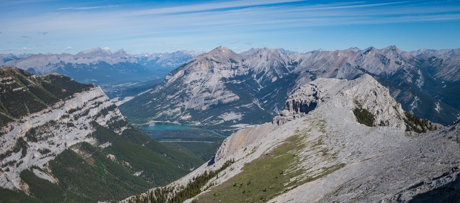 The northwesterly summit view towards Canmore and Grotto Mountain. McGillivray's upper ridge extends for a long distance on the right.
